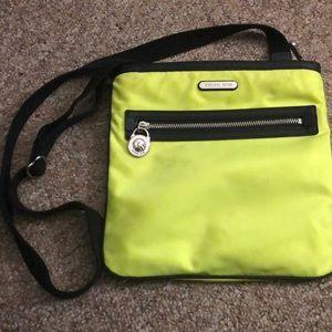 Neon yellow crossbody Michael Kors purse